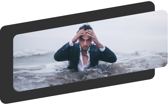 man with his hands on his head as water is rising around him